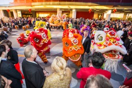 Lucky Dragon Hotel & Casino Grand Opening - 12.3.16 - A crowd gathers as a traditional lion dance is performed (2)